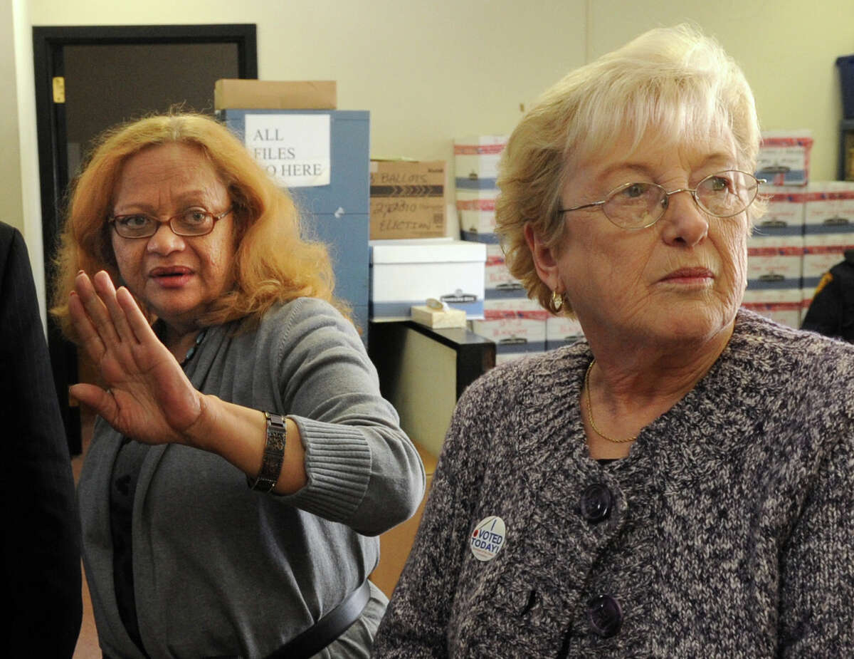 Democratic Registrar Sandi Ayala and Republican Registrar Linda Grace in 2011.