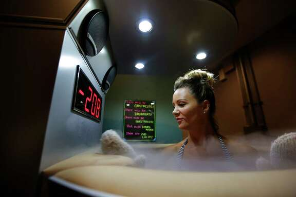 Amber Sine watches the temperature drop during a cryosauna treatment at Chilled Cryospa in Katy, Tuesday, Aug. 16, 2016, in Houston. ( Mark Mulligan / Houston Chronicle )