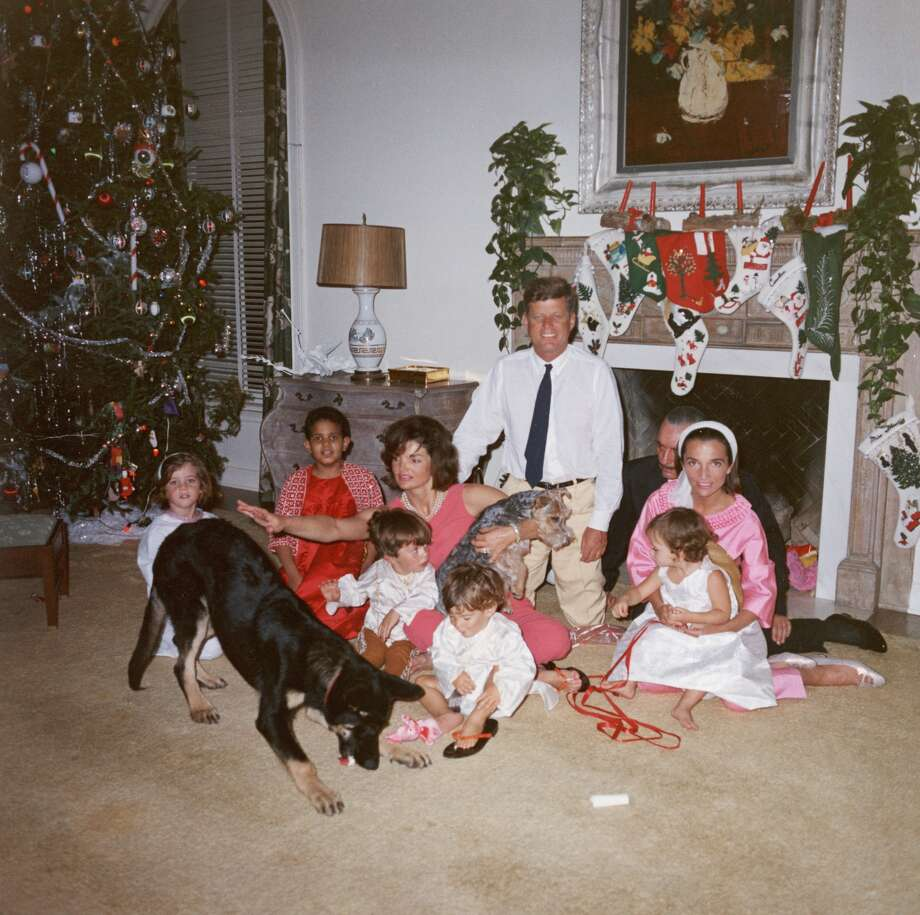 President John F. Kennedy and First Lady Jacqueline Kennedy pose with their family on Christmas Day at the White House, Washington, D.C., December 25, 1962. (L-R): Caroline Kennedy, unidentified, John F. Kennedy Jr., Anthony Radziwill, Prince Stanislaus Radziwill, Lee Radziwill, and their daughter, Ann Christine Radziwill. (Photo by John F. Kennedy Library/Courtesy of Getty Images)