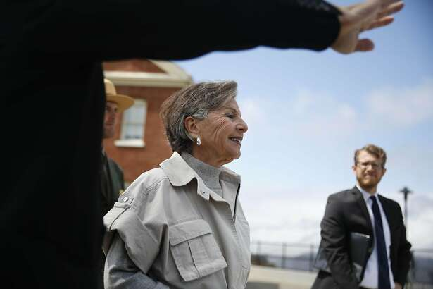 Senator Barbara Boxer (center) talks with Michael Boland (left), acting executive director Presidio Trust, as they walk to the future site of the Presidio Tunnel Tops for a press event  on Friday, August 26,  2016 in San Francisco, California.