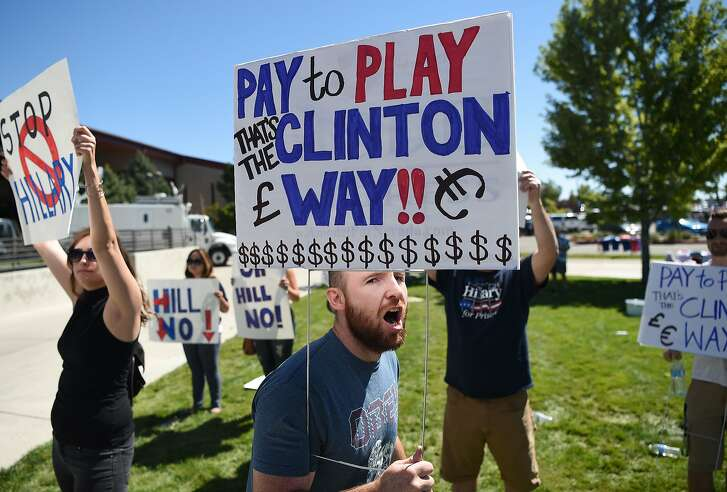 A small group of protesters shout as people wait to enter a campaign event where Democratic presidential candidate Hillary Clinton will speak in Reno, Nevada on August 25, 2016.  / AFP PHOTO / JOSH EDELSONJOSH EDELSON/AFP/Getty Images