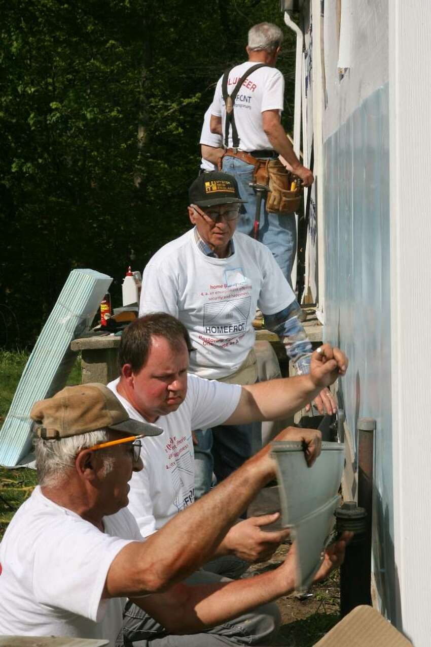 Church of the Good Shepherd volunteers, from left to right, Art Guillegte, Dan Svenlak, John Pasqualucci, Jim Lukowski, and Pierre Cayer side a home in Seymour as part of the 23rd annual HomeFront day on Saturday, May 1, 2010.
