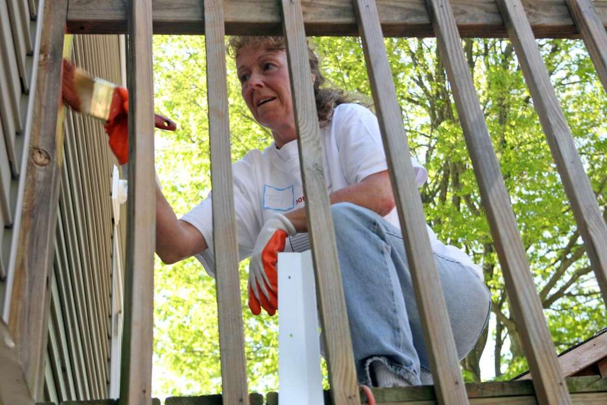 Church of the Good Shepherd volunteer, Terry Brandon, paints a deck of a Seymour home as part of the 23rd annual HomeFront day on Saturday, May 1, 2010.
