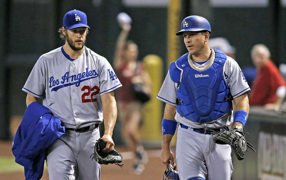 Dodgers ace Clayton Kershaw and his personal catcher, A.J. Ellis both cried after Ellis was sent to the Phillies in a trade of backup catchers. Photo: Ross D. Franklin, Associated Press