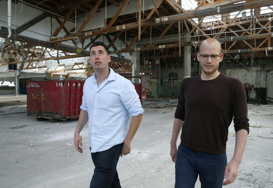 Danny Haber (left) and business partner Yaniv Lushinsky discuss construction plans at a for mer artist ware house at 1919 Mar ket St. in West Oakland, where their S.F. firm is creating 63 apartments. Photo: Paul Chinn, The Chronicle