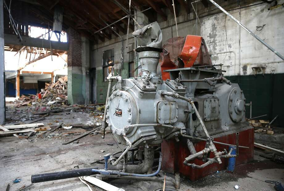 Machinery remains during demolition of the abandoned warehouse, which was vacated of its tenants in January and purchased by San Francisco real estate firm the Negev. Photo: Paul Chinn, The Chronicle