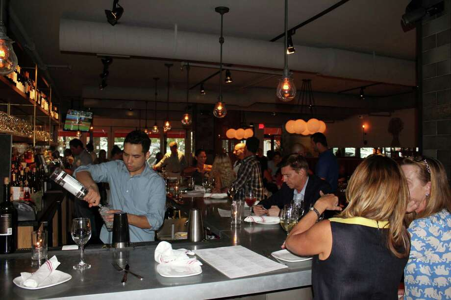 People flock to Spiga, one of the five mandatory stops in the Taste of the Town on Aug. 25, 2016 in New Canaan, Conn. Photo: Contributed / Hearst Connecticut Media / New Canaan News