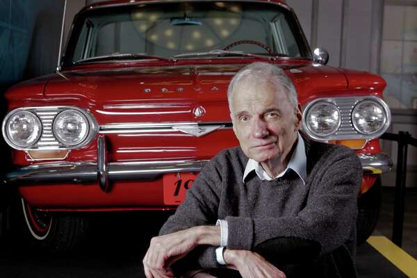 """Ralph Nader, a native of WInsted, where he founded the American Museum of Tort Law, sits in front of the infamous Corvair he wrote about 50 years ago in the book, """"Unsafe at Any Speed."""" The car had the engine in the rear and its rear wheels often did not all touch the pavement on turns. It was unsafe, and Nader's claims prompted GM to stop producing and selling the vehicle. It is a prominent fixture in the museum."""