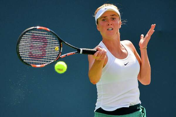 NEW HAVEN, CT - AUGUST 26:  Elina Svitolina of Ukraine returns a shot to Johanna Larsson of Sweden on day 6 of the Connecticut Open at the Connecticut Tennis Center at Yale on August 26, 2016 in New Haven, Connecticut.  (Photo by Alex Goodlett/Getty Images)
