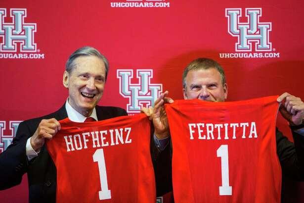 Former Mayor Roy Hofheinz, left, and Tilman Fertitta were on the same team during a news conference announcing Fertitta's $20 million gift to the University of Houston to renovate the school's basketball arena.  ( Brett Coomer / Houston Chronicle )