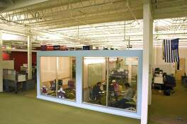 Rackspace Hosting employees are seen at work in this photograph taken in August. On Monday, the company responded to a lawsuit filed by California e-commerce company i3Brands Inc.