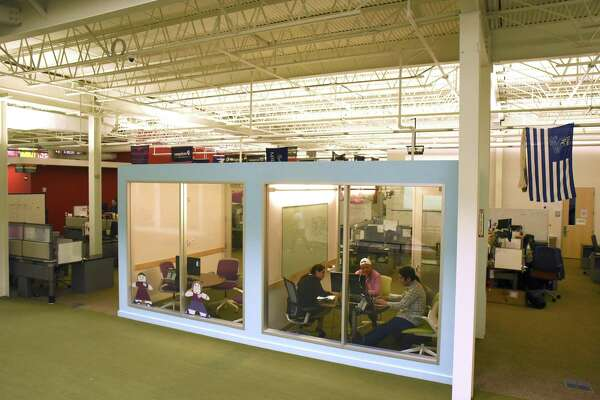 Young people looking for jobs in the tech industry may want to consider cities such as San Antonio, Austin or Salt Lake City, says Katie Bardaro, vice president of data analytics for PayScale, a compensation data and software company. Employees of cloud computing company Rackspace are shown in its Windcrest office in 2016.