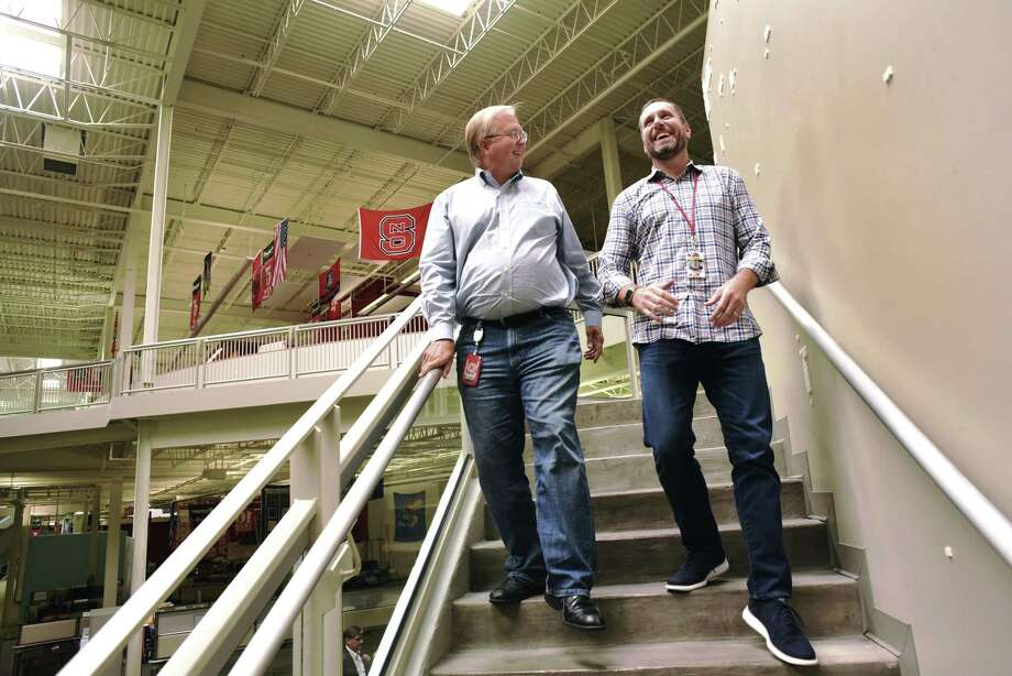 Taylor Rhodes (right), with Graham Weston, co-founder and former chairman of the board of Rackspace, has been named chief executive officer of SMS Assist, a Chicago-based technology company. Photo: Billy Calzada /San Antonio Express-News / San Antonio Express-News