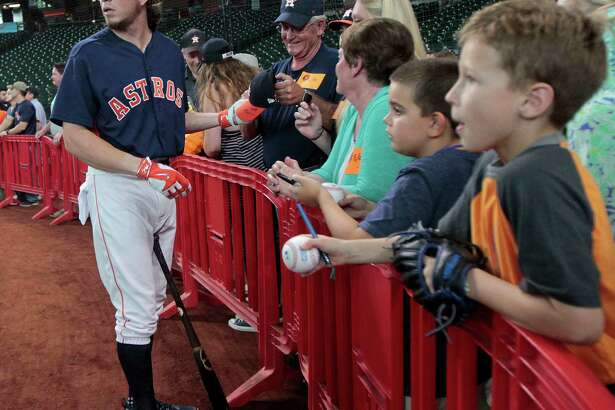 Houston Astros left fielder Colby Rasmus signs autographs during batting practice before an MLB game at Minute Maid Park, Friday, Aug. 26, 2016 in Houston.