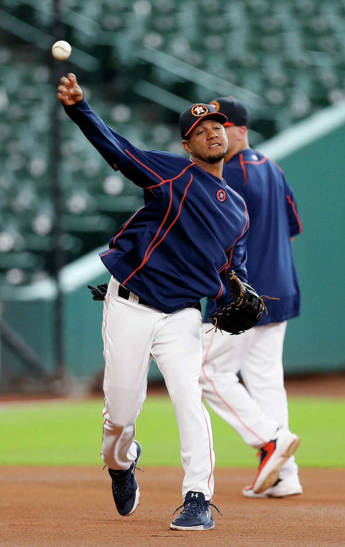 Houston Astros designated hitter Yulieski Gurriel throws the ball during batting practice before an MLB game at Minute Maid Park, Friday, Aug. 26, 2016 in Houston.