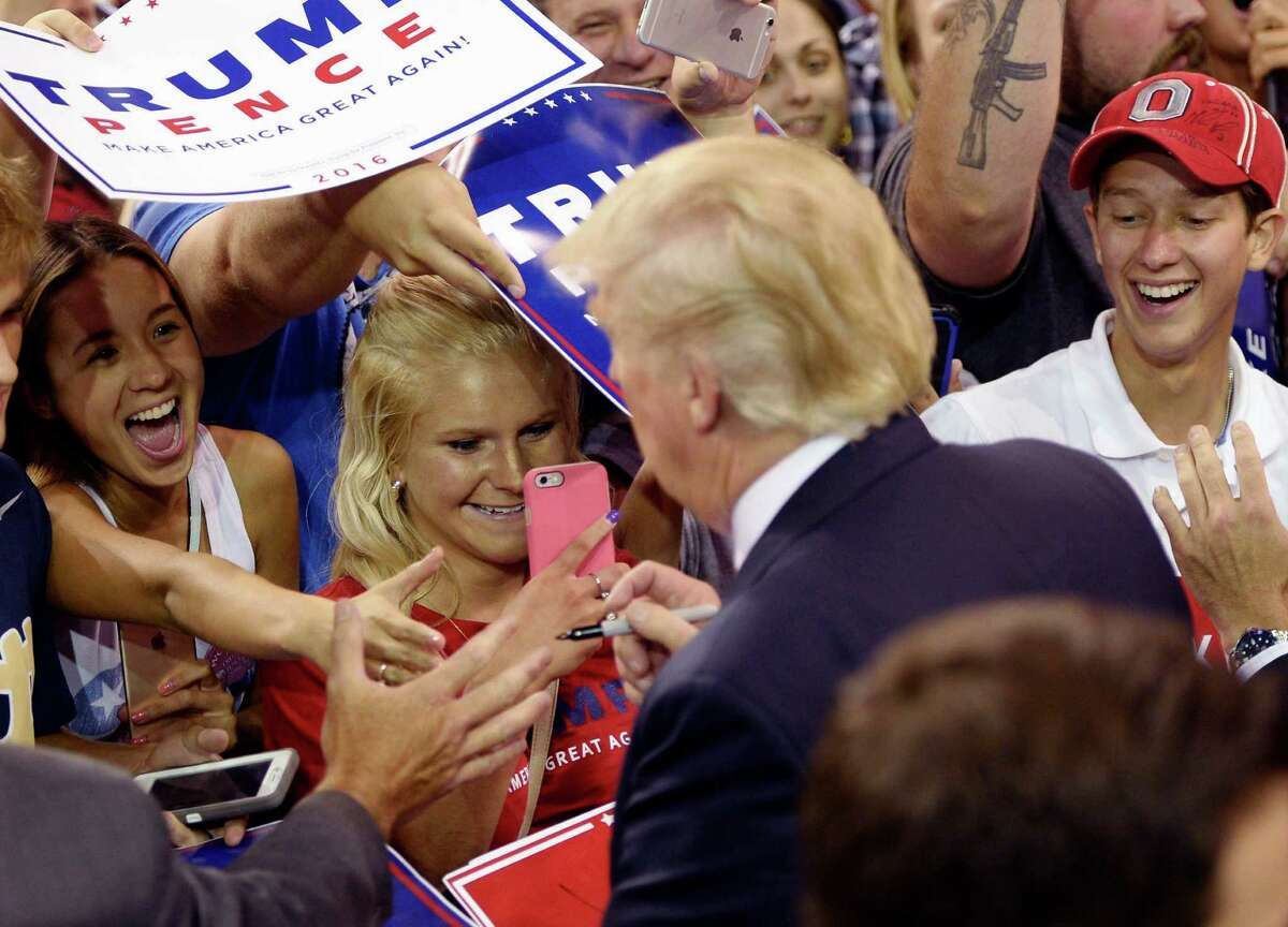 Spectators cheer as Donald Trump works the crowd following the Republican presidential candidate's rally at Erie Insurance Arena on Friday, Aug. 12, 2016, in Erie, Pa. (Andy Colwell/Erie Times-News via AP)