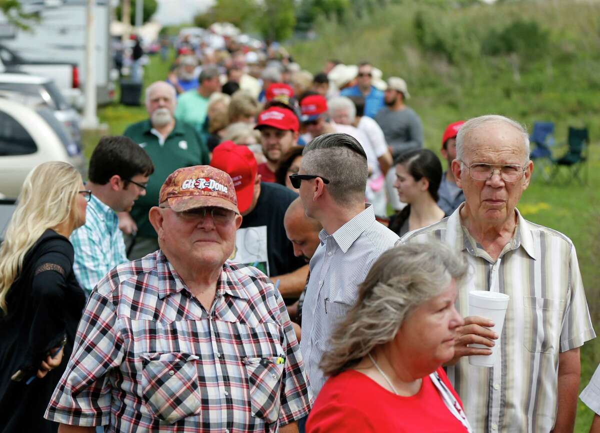 People wait in line to enter to hear Republican presidential candidate Donald Trump speak at a rally in Dimondale, Michigan. According to a recent Farm Futures survey of 1,178 farmers, Trump has the support of 73 percent of farmers, compared to the 10 percent who favor Clinton.