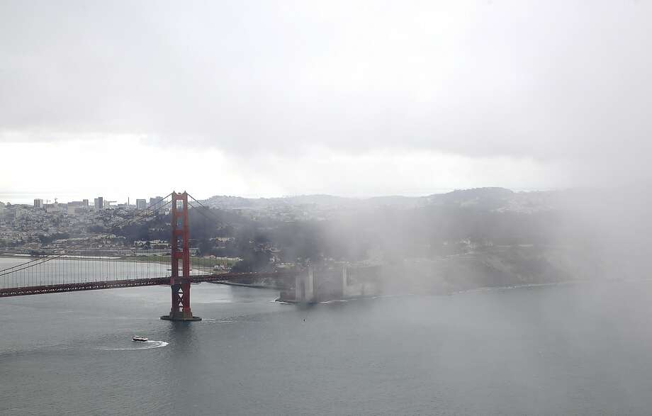 Fog seen over San Francisco from north side of the bridge on Friday, August 26, 2016, in Sausalito, Calif. Photo: Liz Hafalia, The Chronicle