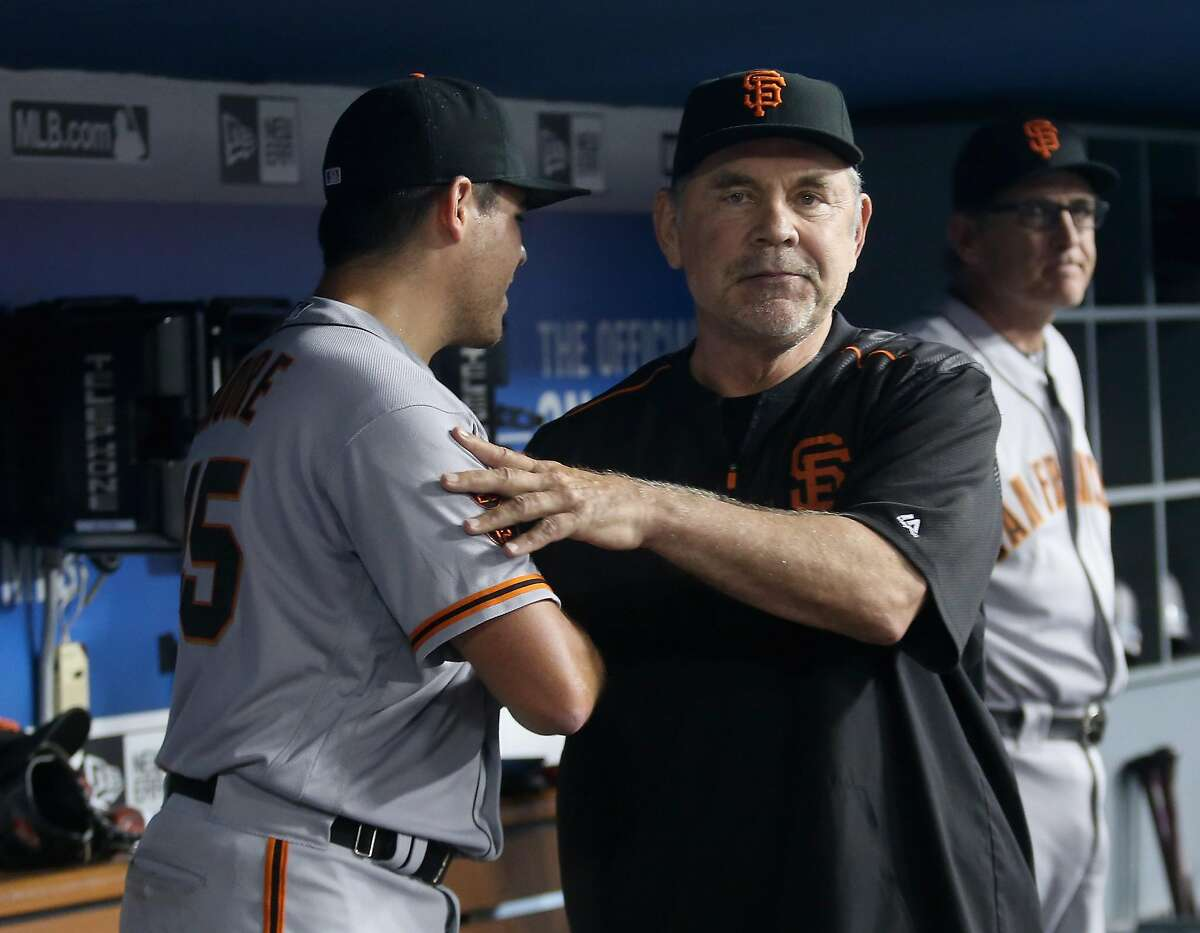 LOS ANGELES, CALIFORNIA - AUGUST 25: Starting pitcher Matt Moore #45 of the San Francisco Giants is congratulated in the dugout by manager Bruce Bochy after Corey Seager #5 of the Los Angeles Dodgers broke up Moore's bid for a no hitter with a single with two outs in the ninth inning at Dodger Stadium on August 25, 2016 in Los Angeles, California. The Giants won 4-0. (Photo by Stephen Dunn/Getty Images)