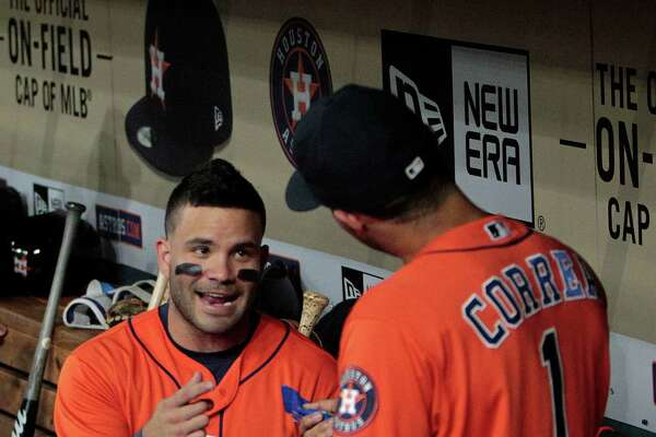 Houston Astros Jose Altuve (27) and  Carlos Correa (1) dance in the dugout before the start of the first inning of an MLB game at Minute Maid Park, Friday, Aug. 26, 2016 in Houston.