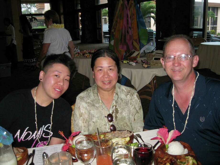 Houston businesswoman Sandy Phan-Gillis, center, seen with her husband Jeff Gillis, right, has been detained by the Chinese government for allegedly being a spy and stealing state secrets. Her husband Jeff Gillis said he is publicizing her ordeal to coincide with the U.S. visit this week of China's President Xi Jinping in hopes of placing pressure on U.S. and Chinese authorities to secure her release. Photo: Courtesy Of Jeff Gillis / Courtesy Of Jeff Gillis