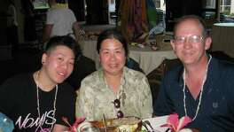 Houston businesswoman Sandy Phan-Gillis, center, seen with her husband Jeff Gillis, right, has been detained by the Chinese government for allegedly being a spy and stealing state secrets. Her husband Jeff Gillis said he is publicizing her ordeal to coincide with the U.S. visit this week of China's President Xi Jinping in hopes of placing pressure on U.S. and Chinese authorities to secure her release.