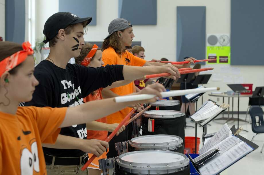 Midland High marching band drum line members practice inside the school's band room Thursday afternoon. Photo: Brittney Lohmiller/Midland Daily/Brittney Lohmiller, Brittney Lohmiller/Midland Daily News