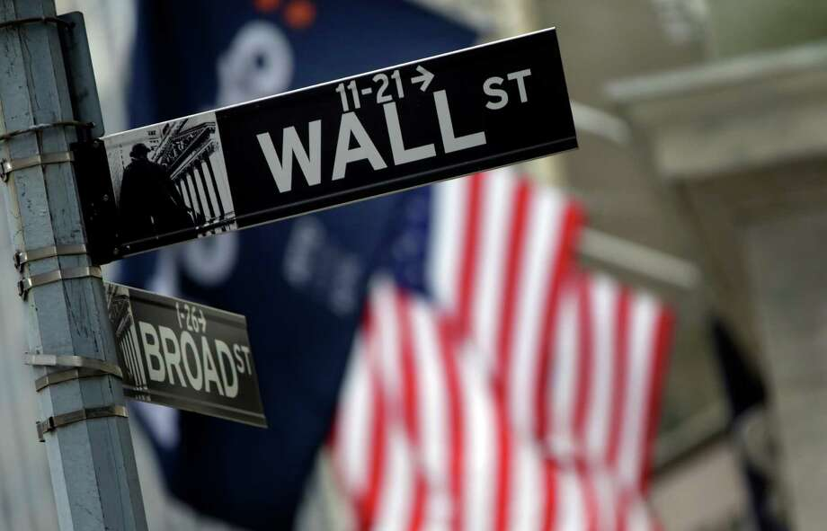 FILE - This Thursday, Oct. 2, 2014, file photo, shows a Wall Street sign adjacent to the New York Stock Exchange. Stocks rose in early trading Friday, Aug. 26, 2016, following two days of declines after Federal Reserve Chair Janet Yellen gave an upbeat assessment on the U.S. economy. (AP Photo/Richard Drew, File) ORG XMIT: NYBZ501 Photo: Richard Drew / Copyright 2016 The Associated Press. All rights reserved. This m