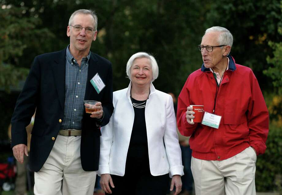 Federal Reserve Chair Janet Yellen, center, strolls with Stanley Fischer, right, vice chairman of the Board of Governors of the Federal Reserve System, and Bill Dudley, the president of the Federal Reserve Bank of New York, before her speech to the annual invitation-only conference of central bankers from around the world, at Jackson Lake Lodge in Grand Teton National Park, north of Jackson Hole, Wyo., Friday, Aug 26, 2016. (AP Photo/Brennan Linsley) ORG XMIT: WYBL102 Photo: Brennan Linsley / Copyright 2016 The Associated Press. All rights reserved. This m