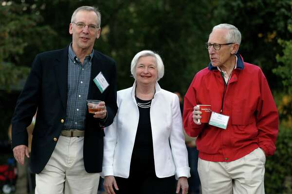 Federal Reserve Chair Janet Yellen, center, strolls with Stanley Fischer, right, vice chairman of the Board of Governors of the Federal Reserve System, and Bill Dudley, the president of the Federal Reserve Bank of New York, before her speech to the annual invitation-only conference of central bankers from around the world, at Jackson Lake Lodge in Grand Teton National Park, north of Jackson Hole, Wyo., Friday, Aug 26, 2016. (AP Photo/Brennan Linsley) ORG XMIT: WYBL102
