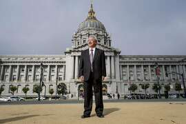 """Edwin """"Ed"""" Lee, mayor of San Francisco, stands for a photograph outside of City Hall in San Francisco, California, U.S., on Wednesday, Aug. 17, 2016. Lee is the first Asian American mayor in San Francisco's history, as well as the first Chinese American elected to the office. Photographer: David Paul Morris/Bloomberg"""