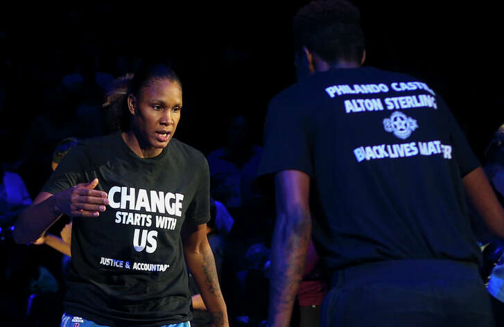 Minnesota Lynx forward Rebekkah Brunson (32) is greeted by Minnesota Lynx forward Natasha Howard (3) while starting lineups are announced at the Target Center on Saturday, July 9, 2016. Lynx players did not wear T-shirts supporting the Black Lives Matter movement ahead of Tuesday's game in San Antonio after four off-duty police officers walked away from security jobs at a Lynx game over the weekend because of the T-shirts.
