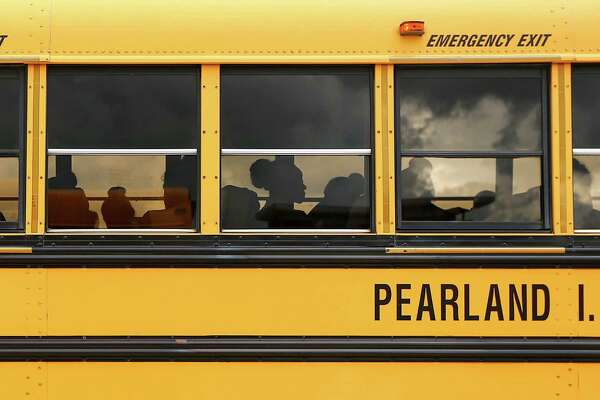 Members of the Pearland High School Prancers wait on a bus before the start of a football game against Clear Springs High School, at Challenger Columbia Stadium, Friday, August 26, in Webster.