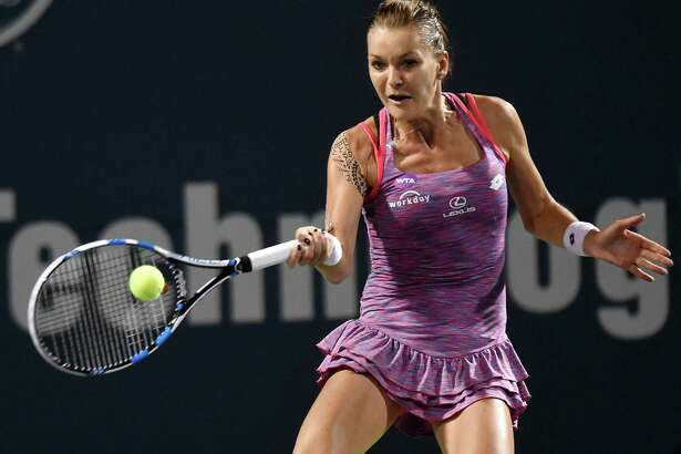 Agnieszka Radwanska, of Poland, hits a forehand against Petra Kvitova, of the Czech Republic, in a semifinal of the Connecticut Open tennis tournament Friday, Aug. 26, 2016 in New Haven, Conn. (Brad Horrigan/The Hartford Courant via AP)