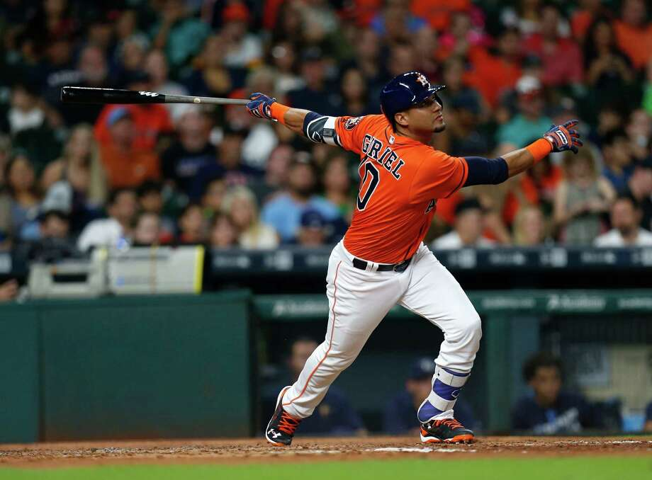 Houston Astros designated hitter Yulieski Gurriel (10) flies out during the fourth inning of an MLB game at Minute Maid Park, Friday, Aug. 26, 2016 in Houston. Photo: Karen Warren, Houston Chronicle / 2016 Houston Chronicle