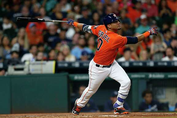 Houston Astros designated hitter Yulieski Gurriel (10) flies out during the fourth inning of an MLB game at Minute Maid Park, Friday, Aug. 26, 2016 in Houston.