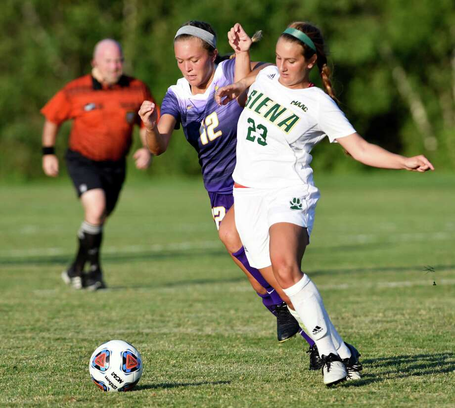 Siena's Meghan Riccardi, right, and UAlbany's Kim Dieroff, center, struggle for control of the ball during their soccer game on Friday, Aug. 26, 2016, at Siena College in Loudonville, N.Y. (Cindy Schultz / Times Union) Photo: Cindy Schultz / Albany Times Union