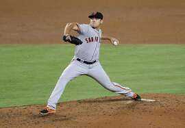 LOS ANGELES, CALIFORNIA - AUGUST 25:  Matt Moore #45 of the San Francisco Giants throws a pitch against the Los Angeles Dodgers at Dodger Stadium on August 25, 2016 in Los Angeles, California.  (Photo by Stephen Dunn/Getty Images)