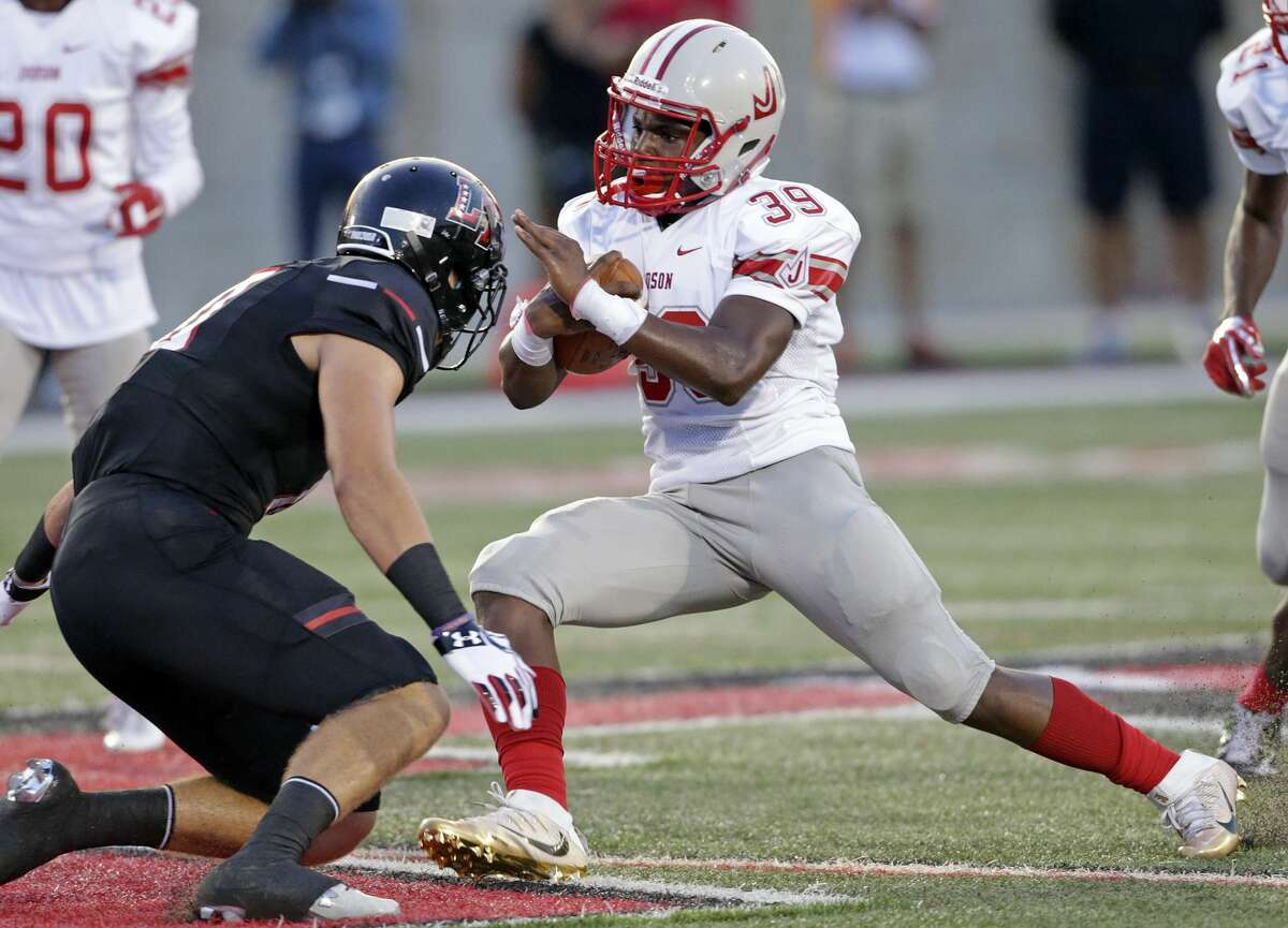 Rocket running back Rashad Wisdom turns to the middle as Judson plays Lake Travis at Cavalier Stadium in Austin on August 26, 2016