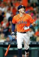 Houston Astros shortstop Carlos Correa (1) watches his home run ball leave the field during the ninth inning of an MLB game at Minute Maid Park, Friday, Aug. 26, 2016 in Houston.