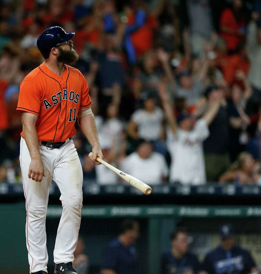 Houston Astros designated hitter Evan Gattis (11) watches his game-winning home run  during the ninth inning of an MLB game at Minute Maid Park, Friday, Aug. 26, 2016 in Houston. Photo: Karen Warren, Houston Chronicle / 2016 Houston Chronicle