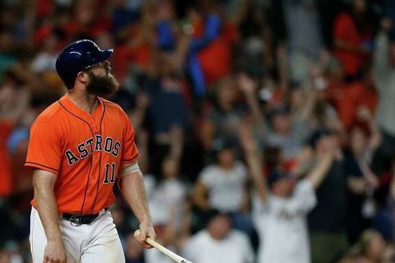Houston Astros designated hitter Evan Gattis (11) watches his game-winning home run  during the ninth inning of an MLB game at Minute Maid Park, Friday, Aug. 26, 2016 in Houston.