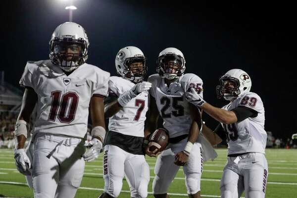 Pearland Oilers defensive back Justin Guy-Robinson celebrates with Triston Gibson, Austin Landry, and Christien Lake after return returning a kickoff for a touchdown during the high school football game between the Pearland Oilers and Clear Springs Chargers at CCISD Challenger Columbia Stadium in Webster, TX on Friday, August 26, 2016.  The Oilers lead the Chargers 14-10 at halftime.