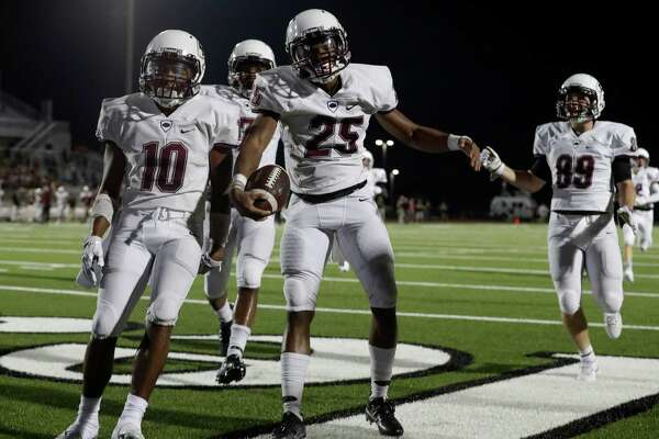 Pearland Oilers defensive back Justin Guy-Robinson celebrates with Triston Gibson after return returning a kickoff for a touchdown during the high school football game between the Pearland Oilers and Clear Springs Chargers at CCISD Challenger Columbia Stadium in Webster, TX on Friday, August 26, 2016.  The Oilers lead the Chargers 14-10 at halftime.