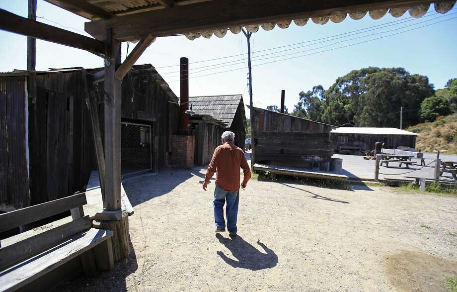 Frank Quan, who lived at the state park, walks to open the gate to the pier at China Camp in 2011. Quan was the last of the shrimpers, the remaining resident of the village established by Chinese immigrants. Photo: Eric Risberg, Associated Press