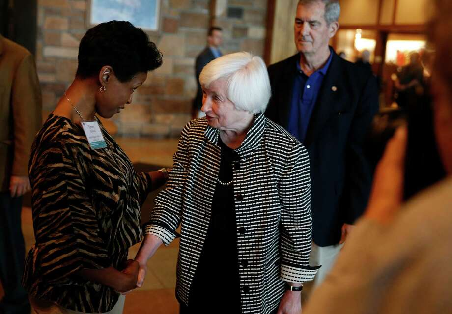 Federal Reserve Chair Janet Yellen, right, greets Tammy Edwards, of the Federal Reserve Bank of Kansas City, as she arrives for a reception on the opening night of the annual invitation-only conference of central bankers from around the world, sponsored by the FRB of Kansas City, at Jackson Lake Lodge in Grand Teton National Park, north of Jackson Hole, Wyo., Thursday, Aug. 25, 2016. Yellen is to address the gathering on Friday. (AP Photo/Brennan Linsley) Photo: Brennan Linsley, STF / Copyright 2016 The Associated Press. All rights reserved. This material may not be published, broadcast, rewritten or redistribu