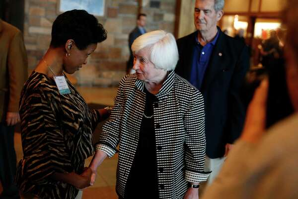 Federal Reserve Chair Janet Yellen, right, greets Tammy Edwards, of the Federal Reserve Bank of Kansas City, as she arrives for a reception on the opening night of the annual invitation-only conference of central bankers from around the world, sponsored by the FRB of Kansas City, at Jackson Lake Lodge in Grand Teton National Park, north of Jackson Hole, Wyo., Thursday, Aug. 25, 2016. Yellen is to address the gathering on Friday. (AP Photo/Brennan Linsley)