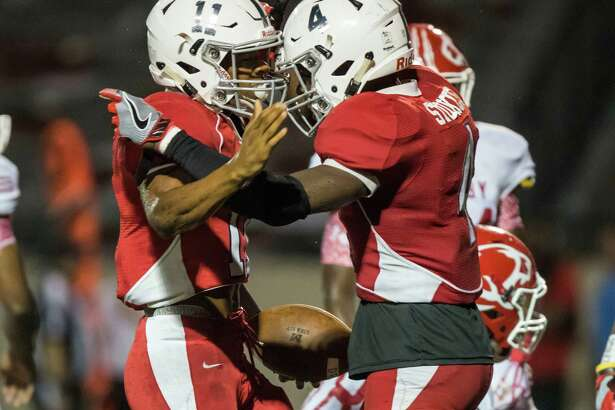 Manvel wide receiver Michael Tolds (11) celebrates with Keylon Stokes after scoring a touchdown just before half time in a high school football game at Memorial Stadium on Friday, August 26, 2016, in Alvin.