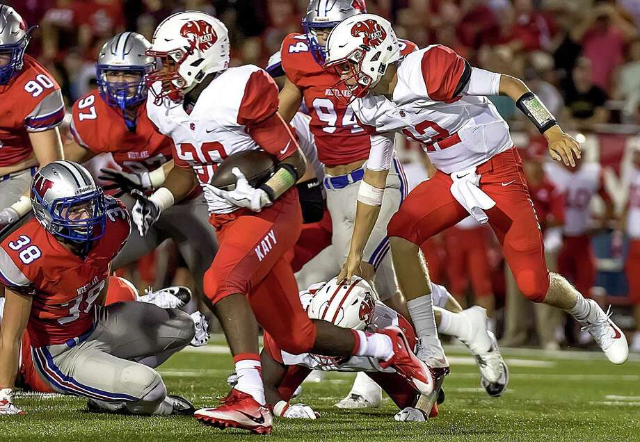 Katys  Deondrick Glass (30) carries for a firs t down during the first football game of the season with the Katy High School Tigers and the Westlake High School Chaparrals played in Austin, Texas, at the Westlake Stadium Friday August 26, 2016. Photo: John Gutierrez, JOHN GUTIERREZ FOR HOUSTON CHRONICAL / © John Gutierrez