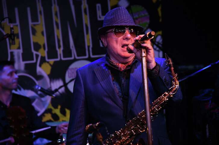 """Van Morrison's """"Brown-Eyed Girl"""" was part of """"happy"""" music played during a workplace experiment. Morrison is shown performing in London this June."""